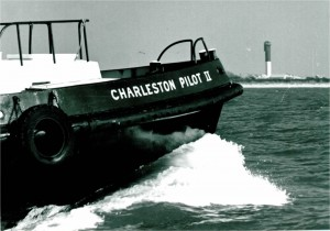 CHARLESTON PILOT II outbound with the Sullivan's Island light in the background.  1979.