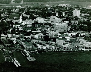 Aerial view of Charleston peninsula, with harbor pilot dock seen in bottom left.  1970's.