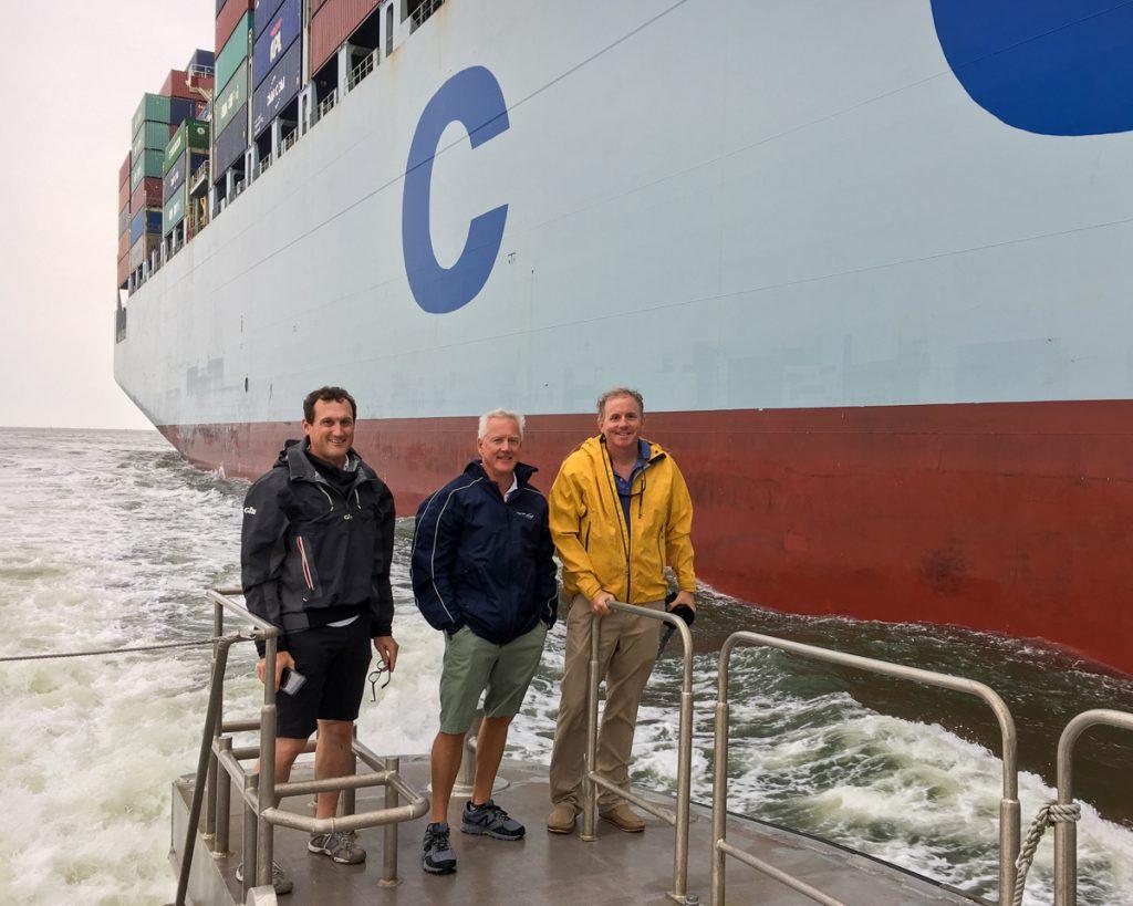 Charleston Pilots Executive Director John Cameron, and pilots C. Walters and J. Dukes